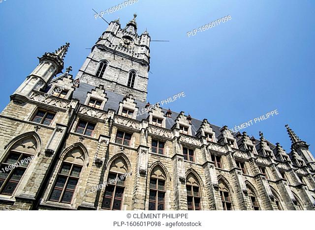 The belfry tower at the Saint Bavo's square / Sint-Baafsplein in the city Ghent, East Flanders, Belgium