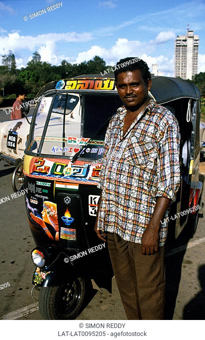 The Auto Rickshaw is one of the main forms of transport in India,and throughout Asia. Scooter with cab. Man