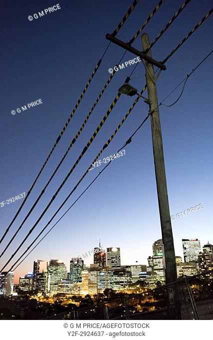 pole and protected power lines with view of North Sydney lights