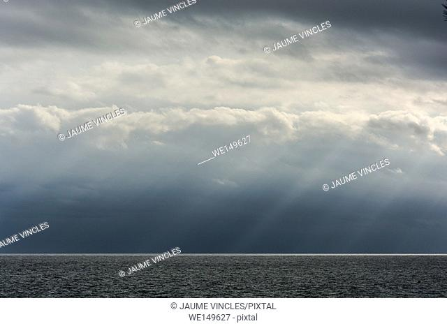 The sky seems to cry tears of light, divine scenery on the coast of Barcelona