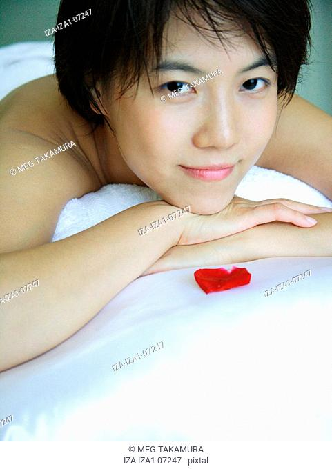 Portrait of a young woman lying on a massage table in a health spa