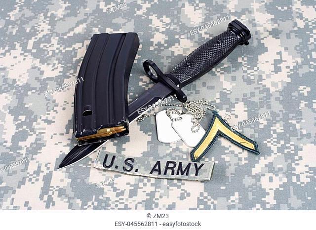 KIEV, UKRAINE - February 6, 2016. M-16 magazine with ammo on camouflage US Army uniform background