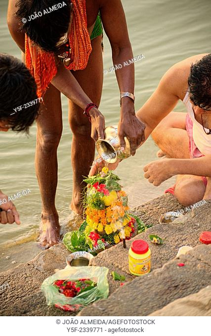 Bathers in the Ganges early in the morning at one of the ghats of Varanasi