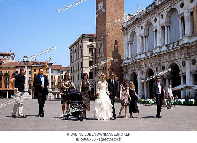 Bridal couple and wedding party on Piazza dei Signori Square, Vicenza, Veneto, Italy, Europe