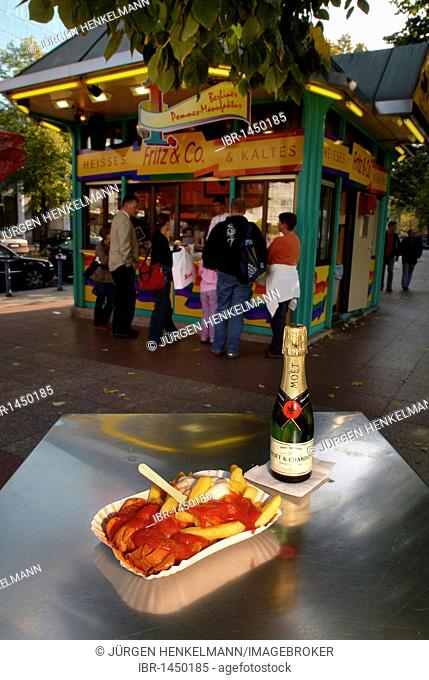Sausage in curry sauce with chips, mayonnaise and ketchup, piccolo champagne, chip stall on Wittenbergplatz Square, Berlin, Germany, Europe