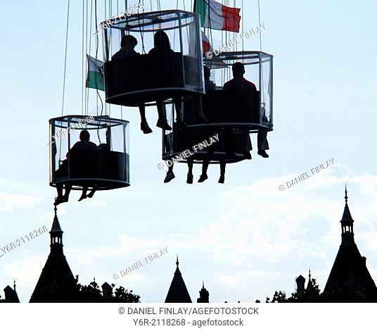 Riders on the Starflyer, near the London Eye, on the banks of the Thames, in the heart of London, ascending to eighty meteres above the city