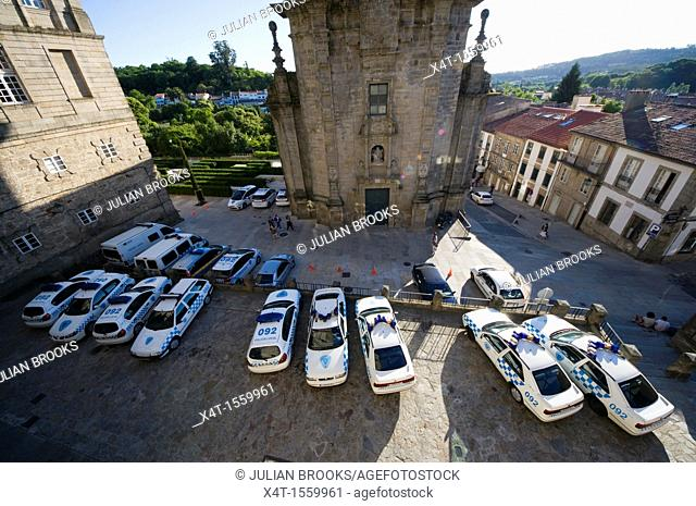 Police cars parked in Santiago De Compostela during a political protest in the Cathedral square