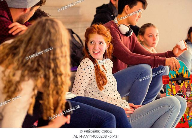 School friends hanging out and chatting together