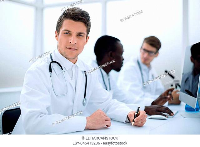 doctor writing down the data in the laboratory journal.the concept of health
