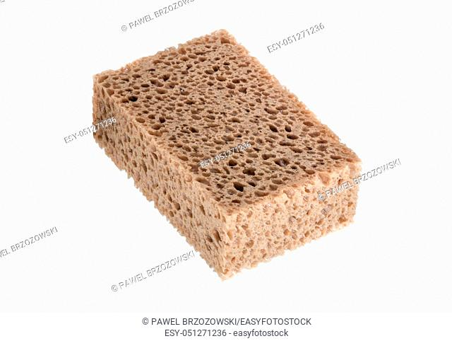 Close-up of cleaning sponge on white background. Big porous sponge isolated on white background