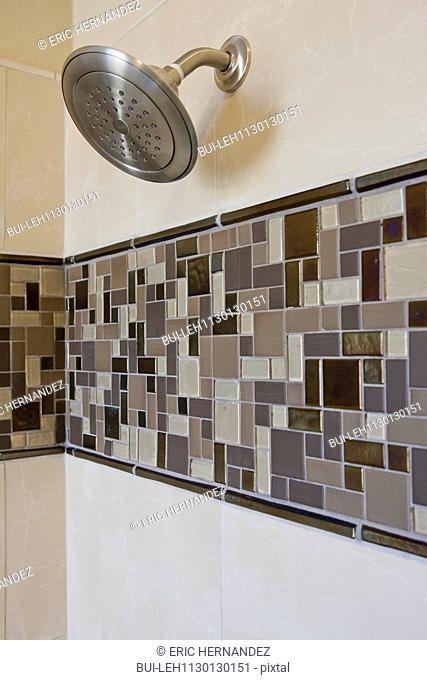 Shower in tiled bathroom