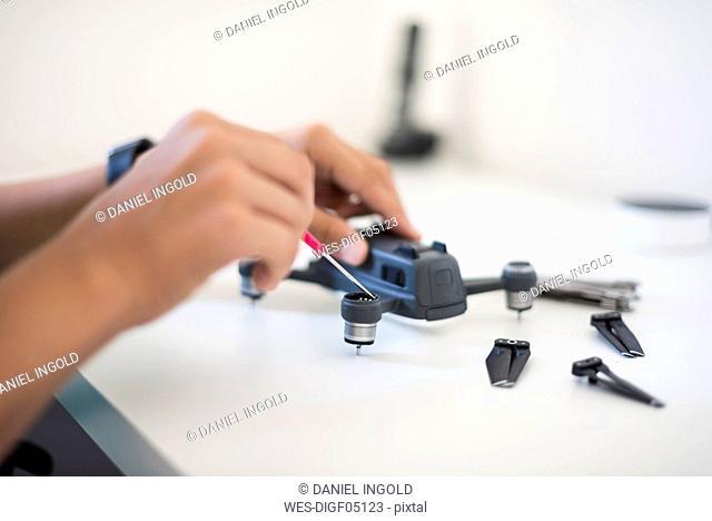 Boy repairing drone