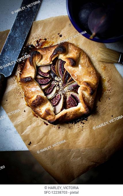 Shortcrust sweet pastry galette, folded and filled with ground almonds and thin slices of fresh pear, fig and with a vanilla sugar crust