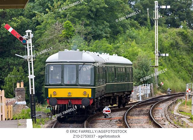 diesel unit ,Class 121 British Rail vintage locomotive ,running on the preserved swanage railway line at Corfe station
