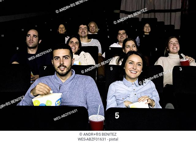 People watching a movie in a cinema