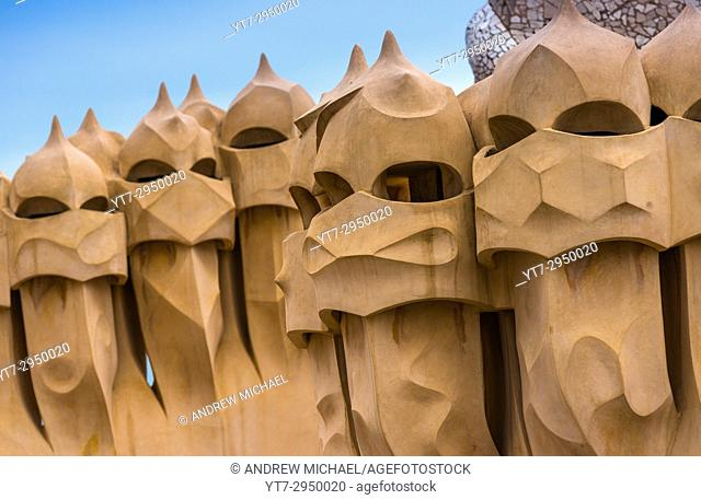 Barcelona, Gaudi's The Pedrera (Casa Mila) on the roof with its unusual chimneys, Catalonia, Spain
