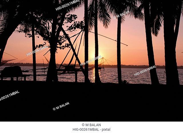 SUNSET NEAR CHINESE NETS IN KUMBALANGHI MODEL TOURISM VILLAGE NEAR KOCHI