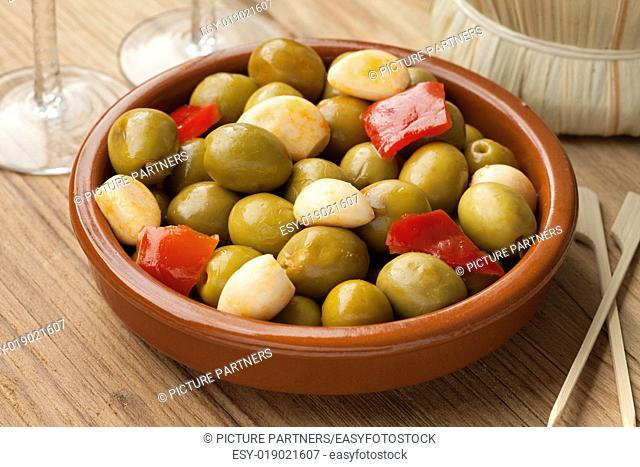 Marinated green olives and garlic as a snack