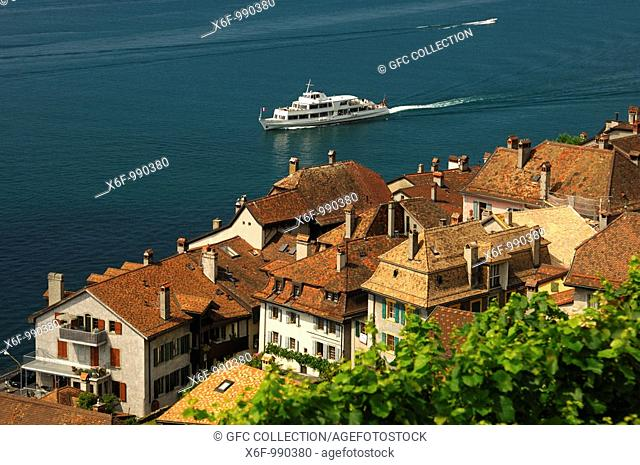 Excursion ship on Lake Leman passing by the medieval town of Saint-Saphorin, UNESCO World Heritage site Lavaux, Vaud, Switzerland