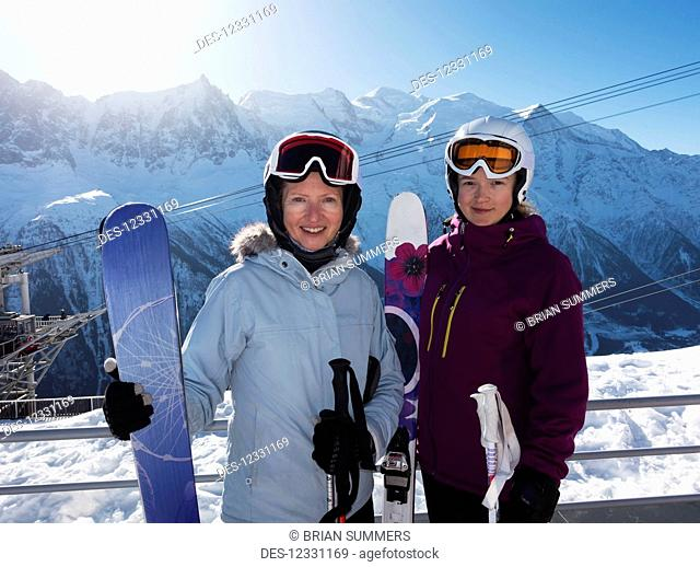 Two Female Skiers Posing At Brevent-Flegere Ski Area; Chamonix, France