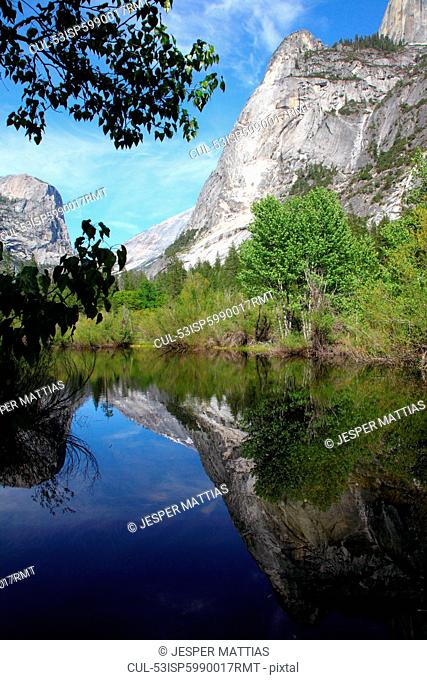 Mountain reflected in still rural lake