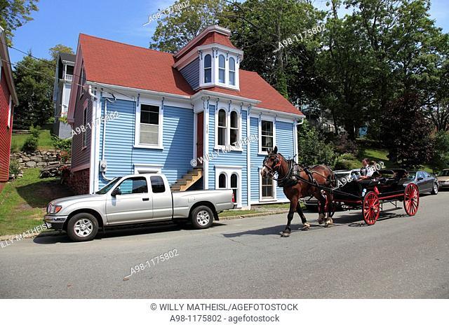 street scene with carriage at UNESCO World Heritage Site city of Lunenburg, Nova Scotia, Canada, North America