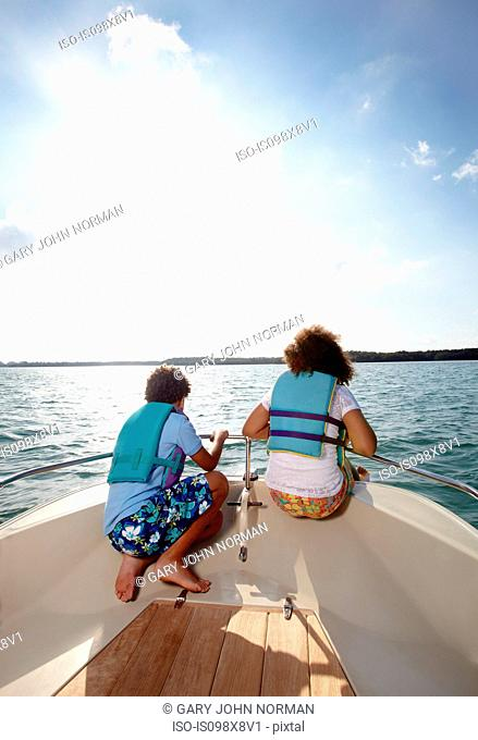 Two children looking at view from motorboat