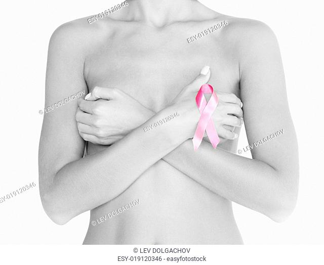 health and medicine concept - naked woman with breast cancer awareness ribbon