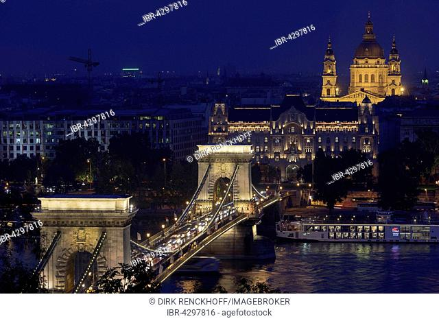 View at night from Buda to Pest riverbank with Chain Bridge, Gresham Palace and St. Stephan, Budapest, Hungary