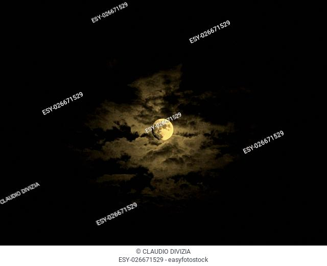 Dark baroque sky with full moon and clouds vintage sepia