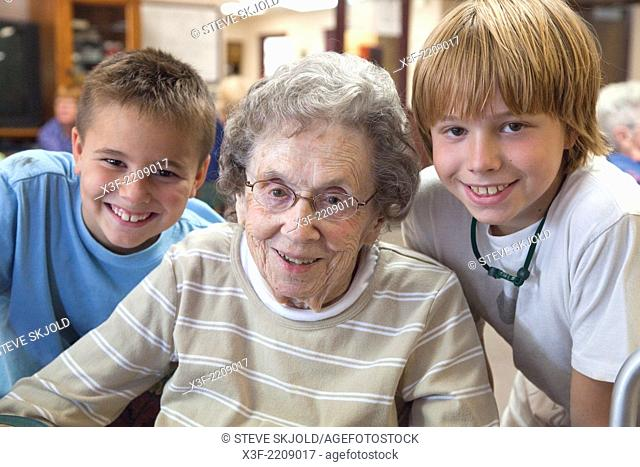 Boys having a fun time with their Great grandmother ages 8, 96 and 11. Battle Lake Minnesota MN USA