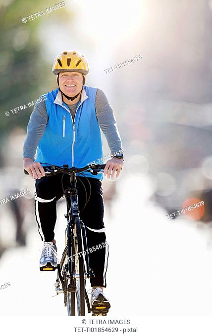 Mature man riding bicycle