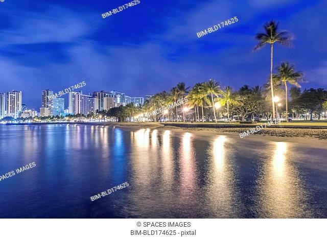 Honolulu city skyline reflection in ocean, Hawaii, United States