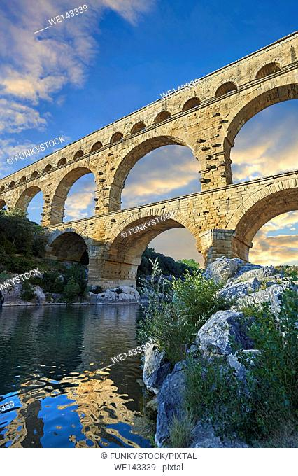 Picture of the ancient Roman Aqueduct of the Pont du Gard which crosses the River Gardon near Vers-Pon-du-Gard, France. Part of the 50 km long aqueduct that...