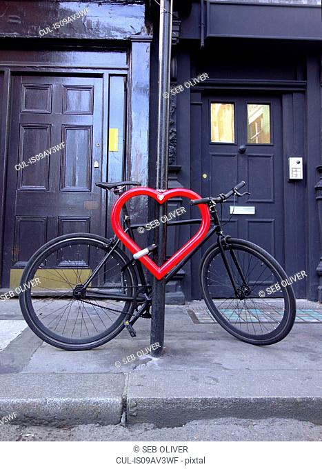 Bicycle secured to heart-shaped post