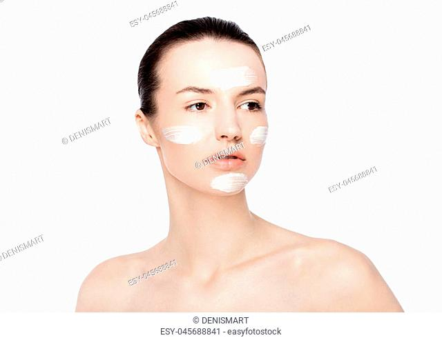 Beautiful woman girl with face cream natural makeup portrait on white background
