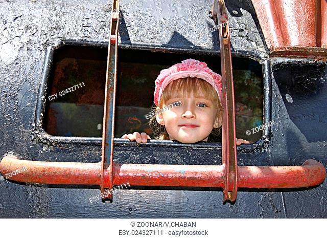 Little girl inside a welded metal attraction