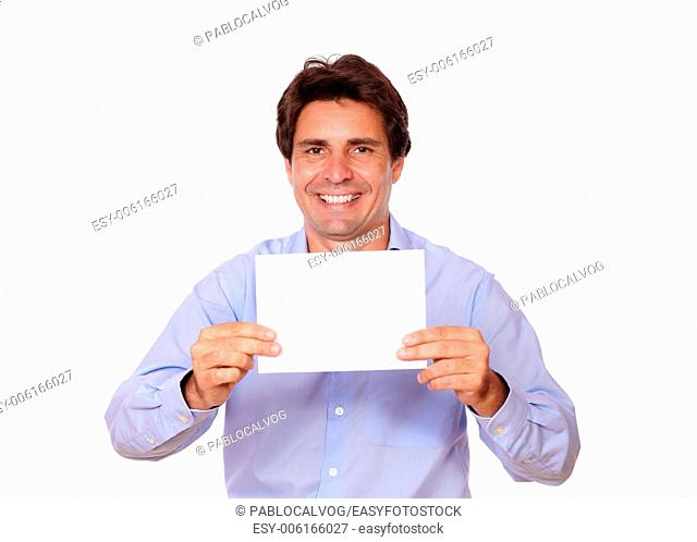 Portrait of a charming positive man holding a blank card of copyspace on isolated background