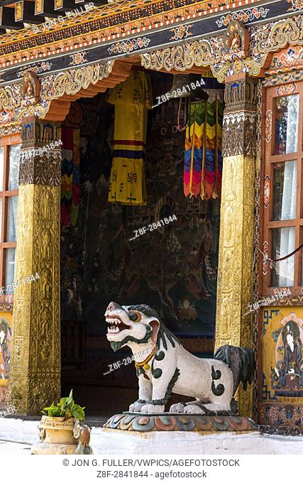 A mythical Tibetan snow lion guards the entrance to the Buddhist temple in Punakha, Bhutan