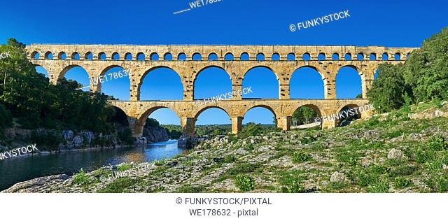 Picture of the ancient Roman Aqueduct of the Pont du Gard which crosses the River Gardon near Vers-Pon-du-Gard, France. Part of the 50 km long aqueduct that...