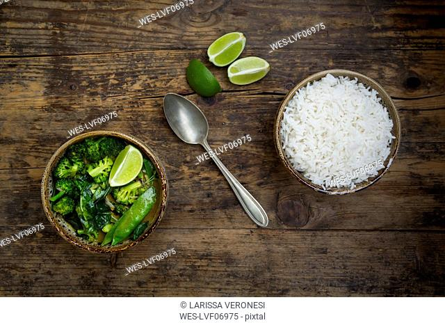 Green thai curry with broccoli, pak choi, snow peas, baby spinach, lime and bowl of rice