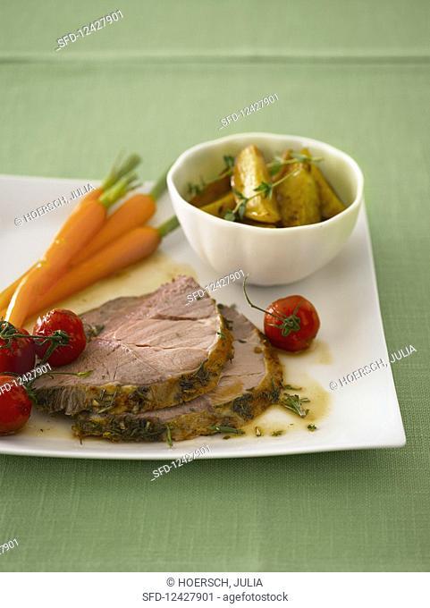 Sliced leg of lamb with garnished vegetables