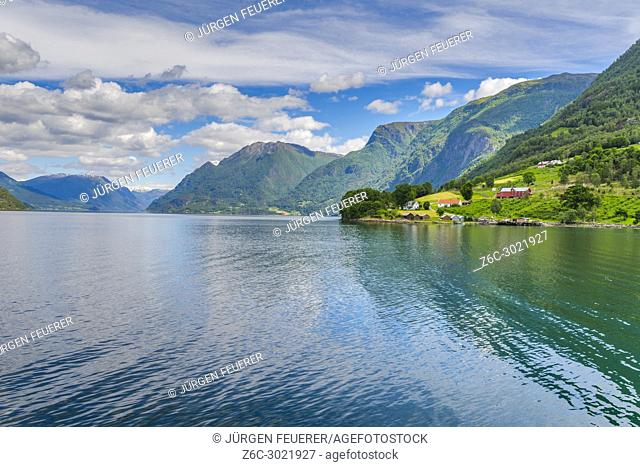 the seashore and ferry stage of Solvorn, Norway, panorama of Lustrafjorden with mountains