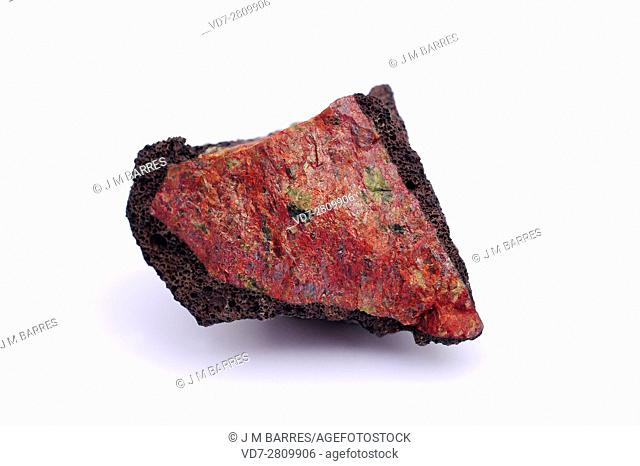 Olivine nodule on basaltic rocks. Olivine is a mineral composed of magnesium iron silicate. . This sample comes from Lanzarote, Canary Islands, Spain