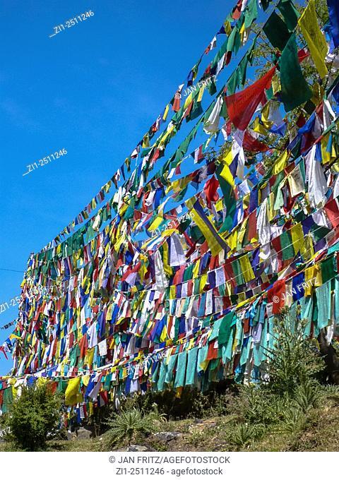 colourful praying flags at tsuglagkhang monastery in dharamsala, india