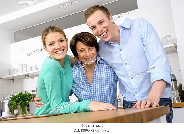 Portrait of youthful grandmother with adult grandchildren