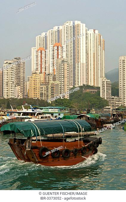 Sampan boat in Aberdeen Harbour, Sampan boat harbour, skyscrapers at Aberdeen Channel at back
