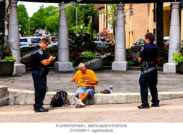 Police officers surround a man for an unknown reason in downtown Madison Wisconsin
