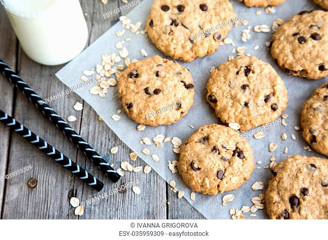 homemade oatmeal cookies with chocolate on an old wooden background