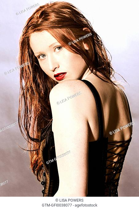 Beautiful young woman with very long red hair